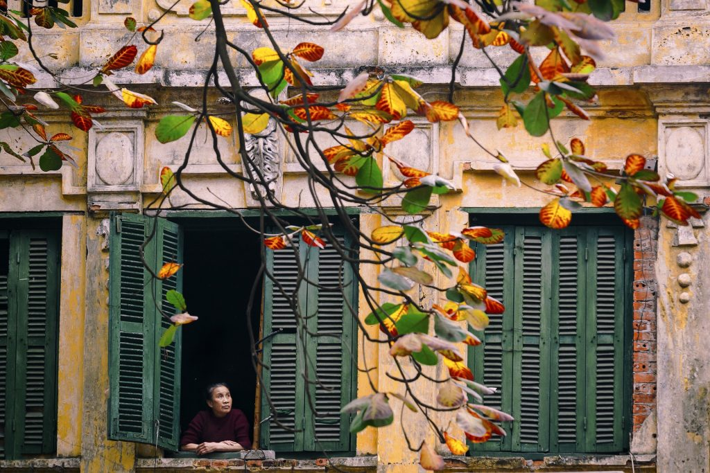 Vietnamese woman at window - 48 Hours in Hanoi